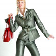 Beautiful Young Woman in gray suit. With a red bag. In the studi — Stock Photo