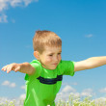 Happy boy enjoy on the meadow — Stock Photo