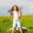 Two fan children playing on the field — Stock Photo