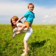 Two fan children playin the field — Stock Photo