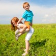 Two fan children playing on the field — Stock Photo #4710873
