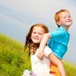 Two fan children playin the field — Stock Photo #4710879