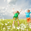 Two golden-haired children playin the field — Stock Photo #4710936