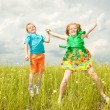 Two golden-haired children playin the field — Stock Photo