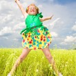 Little girl jumping against beautiful sky — Stock Photo #4710960