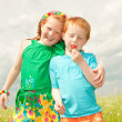 Stockfoto: Two golden-haired children playin the field