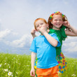Photo: Two golden-haired children playin the field