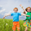 Two golden-haired children playin the field — Stock Photo #4710989