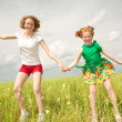 Mom and Daughter Having Fun in the field. Foces on eyes. — Stock Photo #4710992