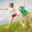 Mom and Daughter Having Fun in the field. Foces on eyes. — Stock Photo #4710997