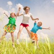 A mother with children Fun in the field — Stock Photo