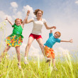A mother with children Fun in the field - Stock Photo