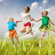 Mother with children Having Fun in the field. Foces on eyes. — Stock Photo