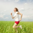 Happy young women runing in field — Stock Photo #4711030