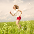 Happy young women runing in field — Stock Photo #4711032