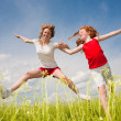 Mom and Daughter Having Fun in field - Stock Photo