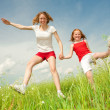 Mom and Daughter Having Fun in the field. Foces on eyes. - Stock Photo
