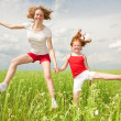 Mom and Daughter Having Fun in the field. Foces on eyes. — Stock Photo #4711075