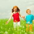 Pretty child having fun in the field — Stock Photo