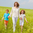 Mother with children Having Fun on field — Stock Photo