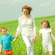 Mother with children goes on field — Stock Photo #4711144