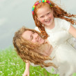 Mother and daughter with flower. Focus on eyes — Stock Photo