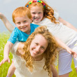Mother with children Having Fun on field — Stock Photo #4711181