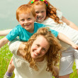 Mother with children goes on field — Stock Photo