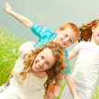 Mother with children goes on field — Stock Photo #4711184