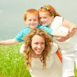 Mother with children goes on field — Stock Photo #4711185