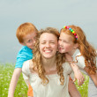 Mother with children goes on field — Stock Photo #4711186