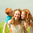 Mother with children goes on field — Stock Photo #4711188