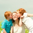 Mother with children goes on field — Stock Photo #4711190