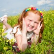 Little beautiful girl outdoor. Lay on the green grass. — Stock Photo #4711220