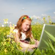 Girl with laptop resting on meadow. — Stock Photo #4711230