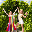 Two happy young women are runing in a park — Stock Photo #4711254