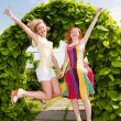 Stock Photo: Two happy young women are runing in a park