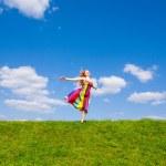 Happy girl fleeing on a meadow. — Stock Photo #4711283