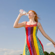 Beautiful girl drinking water against blue sky 3 — Stock Photo
