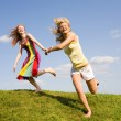 Two happy girls jumping — Stok fotoğraf