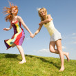 Two happy girls jumping — Stock Photo