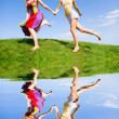 Two happy young women are runing in a field — Stock Photo #4711317