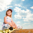 Pretty girl having fun under blue sky — Stock Photo
