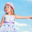 Portrait of smiling girl in blue sky — Stock Photo #4711406