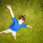 Happy boy enjoy on the meadow — Stock Photo #4711418
