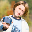 Boy Showing Phone Outdoors. Soft focus. — Stock Photo #4711497