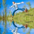 Stock Photo: Happy jumping boy