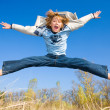 Happy jumping boy - Stock Photo