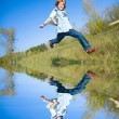Happy jumping boy - Foto Stock