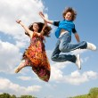 Girl and boy jumping — Stock Photo #4711542